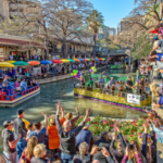 Riding in a boat through the River Walk, one of the most fun things to do in San Antonio for couples