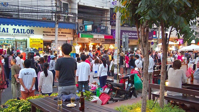 People standing up for the Thai national anthem