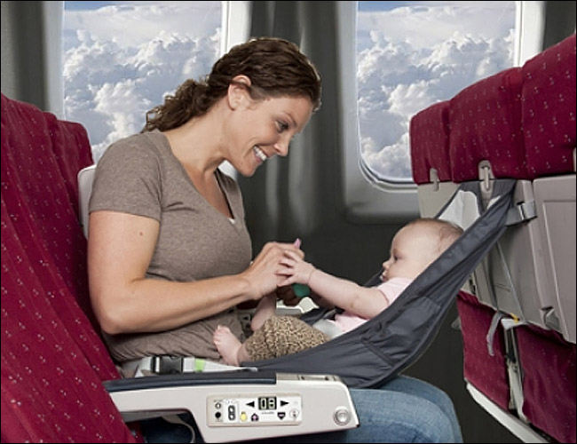 young mom flying with a baby