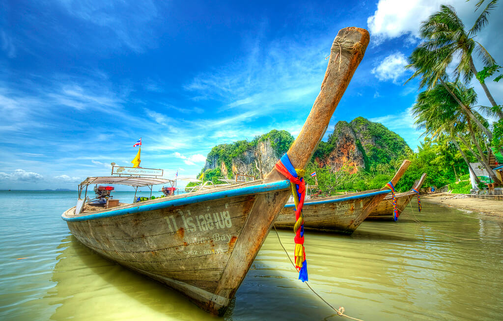 Railay beach thailand can be accessed by longtail boats
