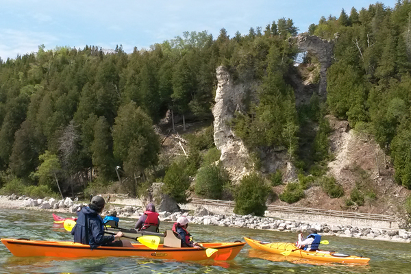 people kayaking near mackinac island