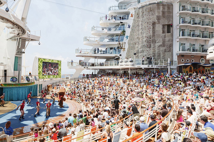 people watching a show on a cruise ship