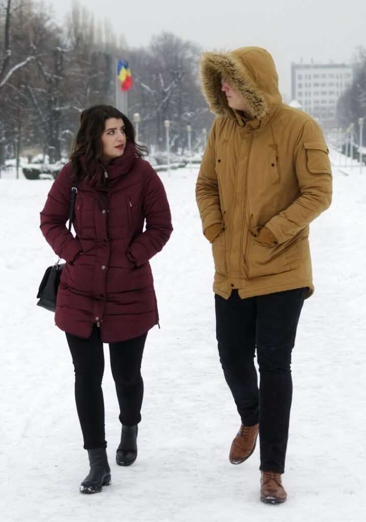 couple walking in the street in winter