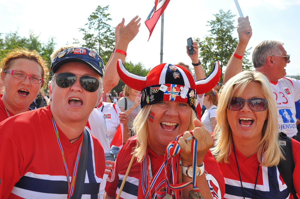 happy Norwegian people with flags